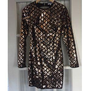 Rose gold sequin dress.